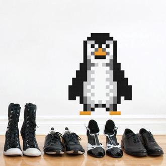 PUXXLE pinguin op de muur